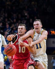 USD's Cody Kelley (10) and SDSU's Noah Freidel (11) chase after the ball during the game on Sunday, Feb. 23, 2020 at Frost Arena in Brookings, S.D.