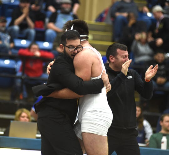 Buffalo Gap coach A.J. Dobzeniecki hugs Seth Fitzgerald after his wrestler won the state championship in Class 2, 220 pounds Saturday, February 22, at the Salem Civic Center.