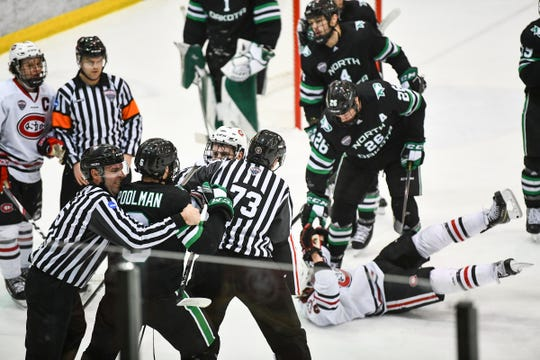 St. Cloud State and North Dakota players wrangle in front of the SCSU goal during the first period of the Saturday, Feb. 22, 2020, game at the Herb Brooks National Hockey Center in St. Cloud.