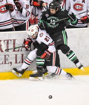St. Cloud State's Jake Wahlin and North Dakota's Mark Senden collide along the boards during the first period of the Saturday, Feb. 22, 2020, game at the Herb Brooks National Hockey Center in St. Cloud.