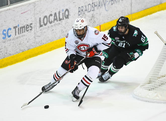 St. Cloud State's Micah Miller skates against North Dakota's Jackson Keane during the first period of the Saturday, Feb. 22, 2020, game at the Herb Brooks National Hockey Center in St. Cloud.