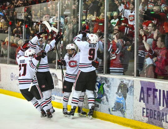 St. Cloud State players celebrate a first period goal by Spencer Meier during the Saturday, Feb. 22, 2020, game at the Herb Brooks National Hockey Center in St. Cloud.