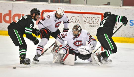 St. Cloud State goaltender David Hrenak concentrates on the puck as players surround the goal during the first period of the Saturday, Feb. 22, 2020, game against North Dakota at the Herb Brooks National Hockey Center in St. Cloud.
