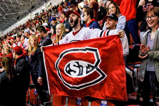 St. Cloud State fans celebrate a goal in the first period of the Saturday, Feb. 22, 2020, game against North Dakota at the Herb Brooks National Hockey Center in St. Cloud.