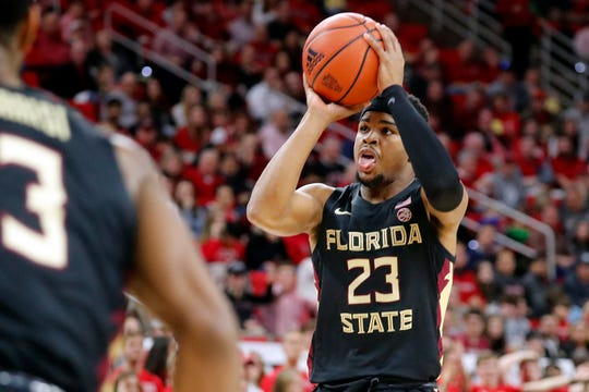 Florida State's M.J. Walker (23) shoots a jump shot against North Carolina State during the second half of an NCAA college basketball game in Raleigh, N.C., Saturday, Feb. 22, 2020. (AP Photo/Karl B DeBlaker)