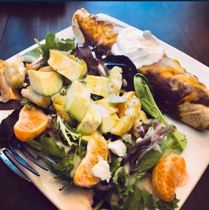 Chicken and black bean enchiladas with a side salad.