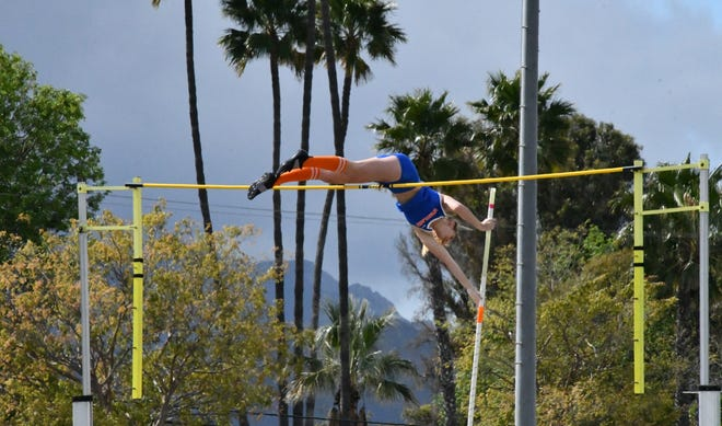 Westlake High junior Paige Sommers gets up and over the bar during the Thousand Oaks Invitational track and field meet on Saturday. Sommers cleared 14 feet, 6 inches to break the California high school girls pole vault record.