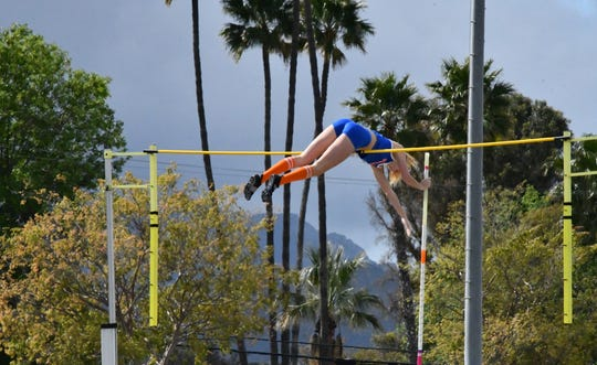 Westlake High junior Paige Sommers gets over the bar during the Thousand Oaks Invitational track and field meet on Saturday. Sommers cleared 14 feet, 6 inches to break the California high school girls pole vault record.