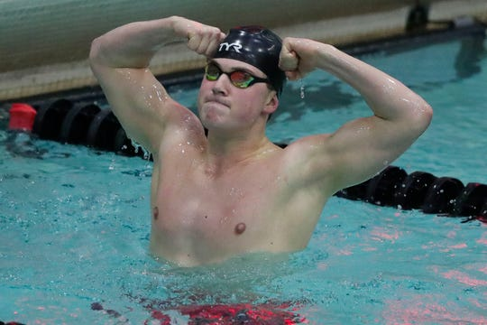SPASH's Drew Harris flexes after winning the 500-yard freestyle during the WIAA Division 1 state swimming and diving meet Saturday in Madison.