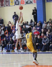 Stepinac's R.J. Davis pictured attempting a 3-point shot. Stepinac defeated Mount St. Michael 99-62 in a CHSAA Archdiocesan quarterfinal game at St. Raymond in the Bronx on Feb. 23, 2020.
