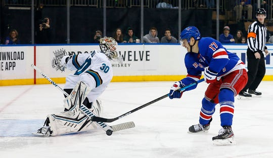 Feb 22, 2020; New York, New York, USA;  San Jose Sharks goaltender Aaron Dell (30) makes a save against New York Rangers right wing Jesper Fast (17) during the second period at Madison Square Garden. Mandatory Credit: Noah K. Murray-USA TODAY Sports