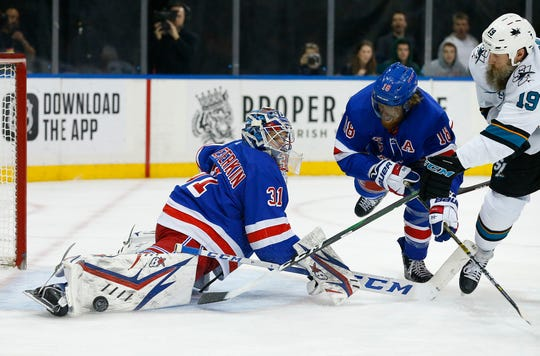 Feb 22, 2020; New York, New York, USA;  New York Rangers goaltender Igor Shesterkin (31) makes a save against San Jose Sharks center Joe Thornton (19) during the first period at Madison Square Garden. Mandatory Credit: Noah K. Murray-USA TODAY Sports