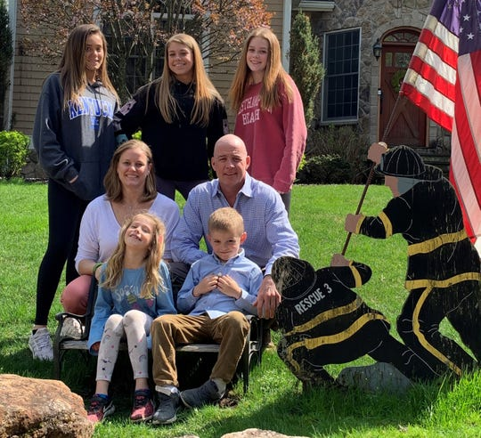 Daniel Foley and his family outside their New Rochelle home in 2019. Foley, a New York City firefighter, died Feb. 22, 2020. His death has been attributed to the 9/11 rescue and recovery.