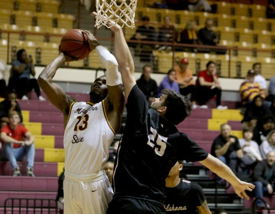 Midwestern State's D'monta Harris goes for a layup by Oklahoma Christian's Will Lienhard Saturday, Feb. 22, 2020, in D.L. Ligon Coliseum.