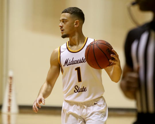 Midwestern State's Elijah Lee dribbles in the game against Oklahoma Christian Saturday, Feb. 22, 2020, in D.L. Ligon Coliseum.