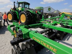 FILE - In this Sept. 10, 2019, file photo a John Deere tractor is on display at the Husker Harvest Days farm show in Grand Island, Neb. Deere & Co. reports earns on Thursday, Feb. 20, 2020.