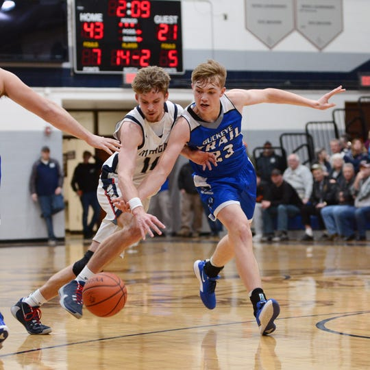 Carver Myers, left, tries to dribble past Buckeye Trail's Garrett Burga in the Raiders' 69-50 win on Saturday night in a Division III sectional game in McConnelsville.