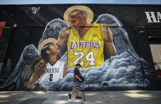 A mural depicting deceased NBA star Kobe Bryant and his daughter Gianna is displayed on a building in Los Angeles.
