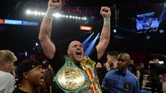 Tyson Fury celebrates after defeating Deontay Wilder in their WBC heavyweight title bout.