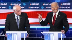 Democratic presidential candidate former Vice President Joe Biden gestures as Sen. Bernie Sanders, I-Vt., listens during the Democratic presidential primary debate in Las Vegas, Feb. 19. 2020.
