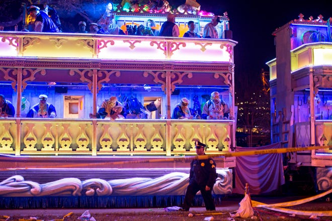 A police officer works the scene where a man was reportedly hit and killed by a float of the Krewe of Endymion parade in the runup to Mardi Gras in New Orleans, Saturday, Feb. 22, 2020.