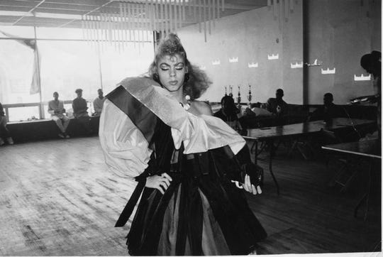 """Venus Xtravaganza, pictured in the Eveningwear category of a Brooklyn ball, 1986, in the community documented by filmmaker Jennie Livingston in her documentary """"Paris is Burning."""""""