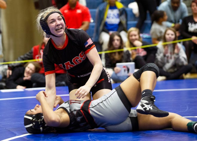 Jackson Memorial Avery Meyers pins Karielys Reyes of Trenton Central in 128 lbs. final. NJSIAA Girls Wrestling South Region tournament in Williamstown, N.J. on February 23, 2020