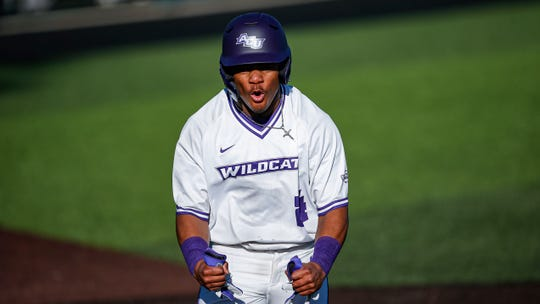 Abilene Christian freshman Cameron Cromer celebrates scoring on an RBI double by junior Colton Eager during the first inning of an NCAA baseball game against Utah Valley on Feb. 14 at Crutcher Scott Field. ACU won 3-2.
