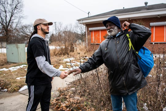 Devon Wilson, 23, greets Washington Heights neighbor Ozzie Davis outside of his farm on Monday, Feb. 24, 2020 in Battle Creek, Mich. Wilson is leasing to own a farm from Sprout with the intention of providing the neighborhood, a food desert, a place to buy healthy food.