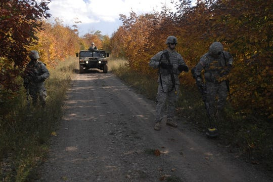 Members of the 1431st Engineer Company search with mine detectors during training in 2014.