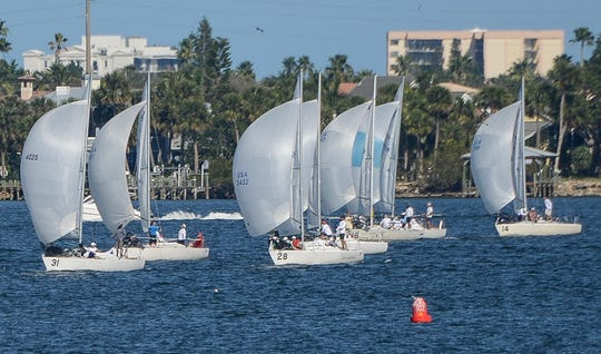 Sailboats line up to start another race during the 2017 J/24 Midwinter Championship in the Indian River in 2017. The races are hosted by the Eau Gallie Yacht Club and the Melbourne Yacht Club.