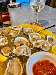 A cool, salty dozen oysters and a crisp glass of wine are the perfect accompaniment for watching cruise ships go by at Rusty's Seafood & Oyster Bar in Cape Canaveral.
