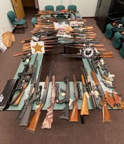 More than 70 firearms were taken during the arrest.