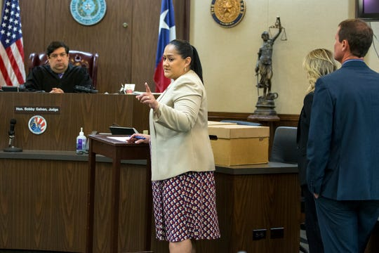 94th District Court Judge Bobby Galvan listens to Prosecutor Angelica Hernandez before the jury is brought in for the start of the capital murder trial of Ausencio Acosta, 22, on Monday, February 24, 2020. Acosta is accused in the shooting deaths of Arturo and Miriam Lopez in the London Estates subdivision in April 2018.