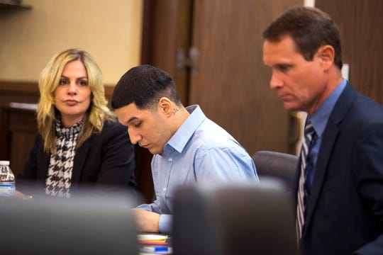 Defense attorneys Lisa Greenberg, left, and Adam Rodrigue, right, sit with their client, Ausencio Acosta, center, 22, on Monday, February 24, 2020. Acosta is accused in the shooting deaths of Arturo and Miriam Lopez in the London Estates subdivision in April 2018.