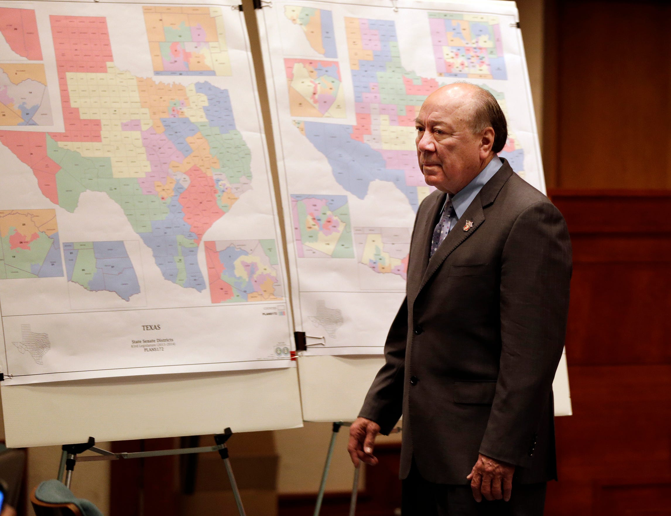 "Sen. Juan ""Chuy"" Hinojosa looks at maps on display prior to a Senate Redistricting committee hearing, Thursday, May 30, 2013, in Austin, Texas."