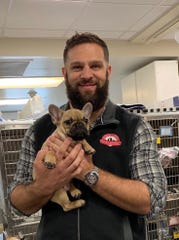 Dr. Chris Torre holds a friend at his Mount Laurel Animal Hospital. Torre is an owner of Dr. Brewlittle's Beer Co. in Maple Shade.