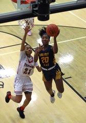 Walnut Hills guard Aniyah Brown scores on this breakaway layup.