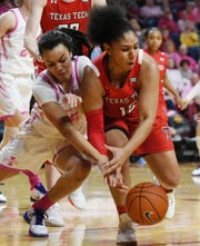 Iowa State's Kristin Scott and Texas Tech's Andrayah Adams battle for a loose ball during the 4th quarter at Hilton Coliseum Sunday, Feb. 23, 2020, in Ames, Iowa.