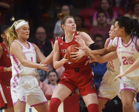 Texas Tech's Brittany Brewer looks for a drive around Iowa State's Madison Wise (left), Kristin Scott (right), and Adriana Camber (13) during the second quarter at Hilton Coliseum Sunday, Feb. 23, 2020, in Ames, Iowa.