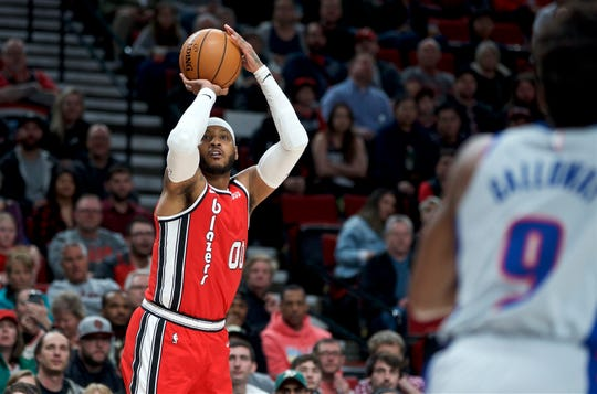 Portland Trail Blazers forward Carmelo Anthony shoots a 3-point basket against the Detroit Pistons during the first half of an NBA basketball game in Portland, Ore., Sunday, Feb. 23, 2020. (AP Photo/Craig Mitchelldyer)