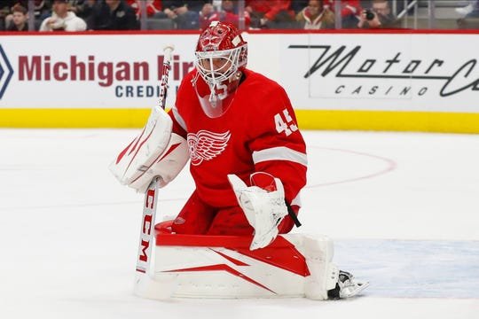 Detroit Red Wings goaltender Jonathan Bernier (45) plays against the Calgary Flames in the second period of an NHL hockey game Sunday, Feb. 23, 2020, in Detroit. (AP Photo/Paul Sancya)