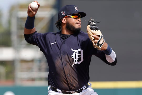 Tigers third baseman Dawel Lugo throws to first base for an out against the Astros after diving to make a stop during the second inning of the Tigers' 11-1 loss in a spring training game against the Astros on Monday, Feb. 24, 2020, in Lakeland, Fla.