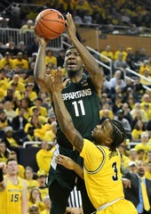 Michigan and Michigan State returned to this week's Associated Press Top 25 college basketball poll.