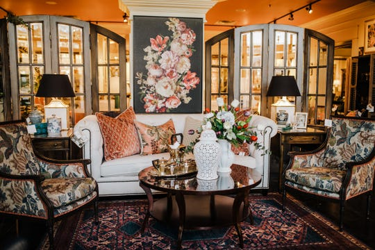 The juxtaposition between the traditional floral pattern on the accent chairs and the geometric coral cut velvet throw pillows is eye-catching and shows how dynamic the right fabric mix can be.