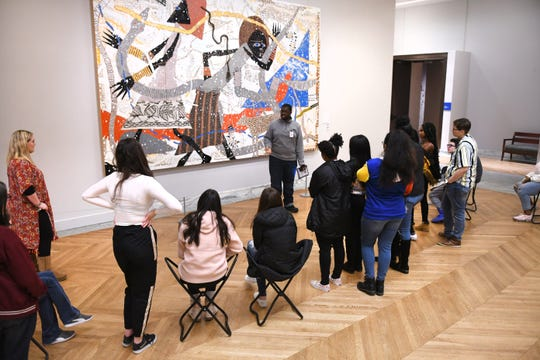 Students from Royal Oak High School listen to Detroit Institute of Arts docent Christian Black (center) speaking of artist Charles McGee and his work titled 'Noah's Ark: Genesis' in Kresge Hall recently. The DIA is seeking a 0.2-mill increase in the March 10, 2020 election.