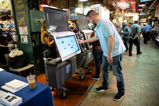 Steve Marcinkus, an investigator with the Office of the City Commissioners, in June demonstrated the ExpressVote XL voting machine at the Reading Terminal Market in Philadelphia. (AP Photo/Matt Rourke, File)