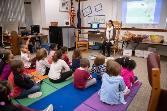 Media specialist Danica Menna speaks to a class in the media center of Ferndale Lower Elementary School in Ferndale. A bond vote in March will decide whether the school will be replaced with a new building.