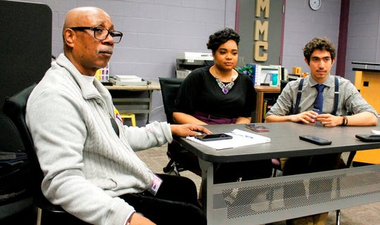 George Hart, a professor at Benedict College in Columbia, S.C., and adviser to the school's student chapter of the NAACP, discusses the upcoming South Carolina Democratic presidential primary with students Faith Dupree and Luis Gonzalez at the historically black college on Friday, Feb. 14, 2020.