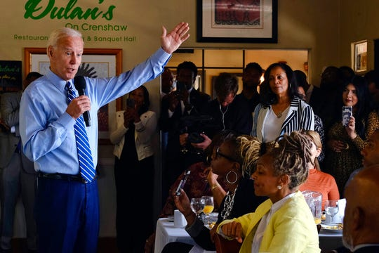 In this July 18, 2019, file photo, Democratic presidential candidate former Vice President Joe Biden speaks to community faith leaders after serving breakfast during a visit to Dulan's Soul Food on Crenshaw in Los Angeles. More than traditional markers of electability like name recognition, fundraising ability or charisma, the path to the Democratic nomination runs through black voters.